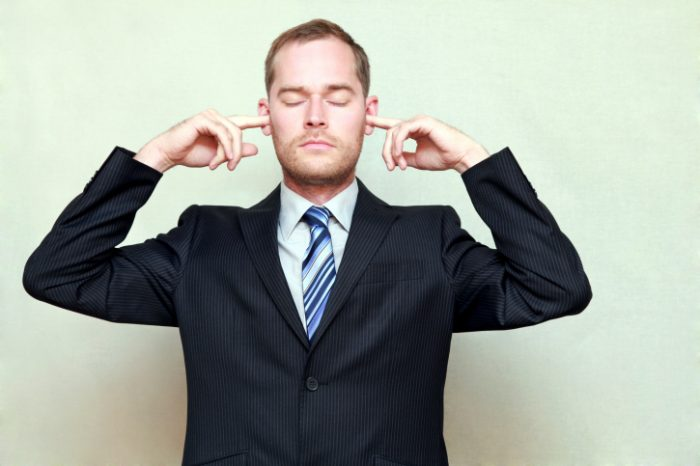 Man Putting Fingers in Ears